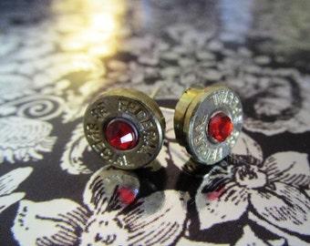 38 Special bullet stud earrings with orange rhinestones