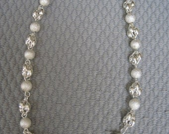 A Little Edgey, Curvy and Shimmering this Sterling Silver Necklace Looks Great