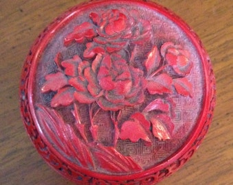 CINNABAR Type TRINKET BOX with brass stand.