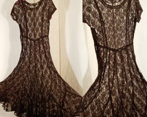 vintage 1950s 1960s black lace mesh dress medium size button closure on the side , perfect no damage no label
