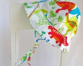 baby boy sun hat in reversible dinosaur and green spot pattern with chin strap