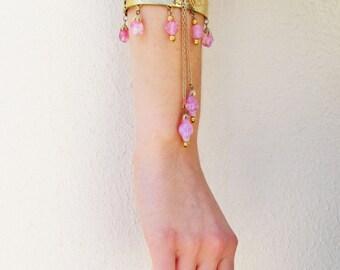 Unusual vintage bracelet, hinged bangle with pink opalescent bead dangles, embossed gold metal bracelet