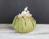 Vintage Nude Porcelain Pincushion, w/ live green tapestry fabric and lace cushion area