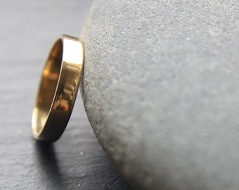 4mm unisex wedding ring in recycled 18ct yellow gold, featuring flat profile and shiny finish - made to order