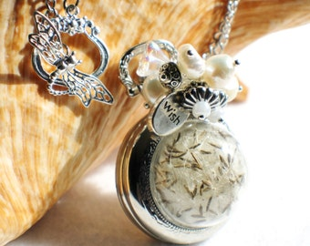 Dandelion seed pocket watch pendant, pocket watch with glass globe filled with dandelion seeds on front cover..