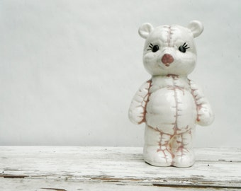 Scary Ceramic Teddy Bear with Pink Stitches.