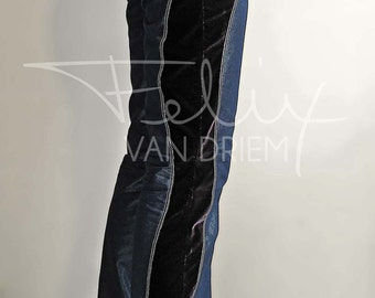 Jeans, slim-fit boot-cut jeans,cotton/polyester blend denim  and midnight blue silk velvet contrast inserts. Definitely not for the timid!