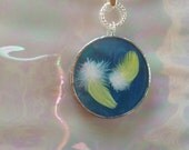 Love is a Circle Stained Glass Pendant. Beautiful yellow feathers in Turquoise Iridescent Glass.