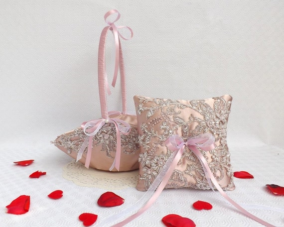 Antique pink wedding ring pillow and flower girl basket decorated with embroidered floral lace.