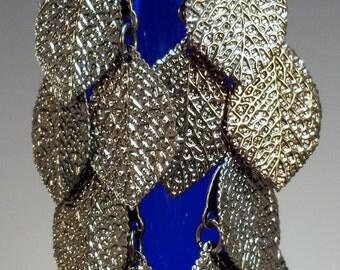 Silver cascade of leaves earrings.