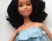 REPAINTED black haired mattel doll with hand painted simple sweet face.  Includes handmade blue pull on peplum knee length dress OOAK