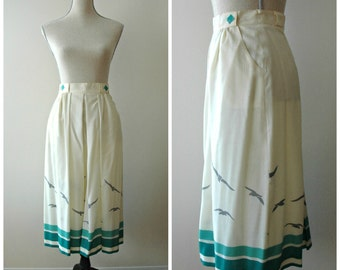 Ombre high waisted skirt with birds in cream, blue and grey and side pockets.