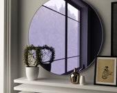 Round purple mirror. Midcentury modern glass mirror made with custom, hand made purple glass.