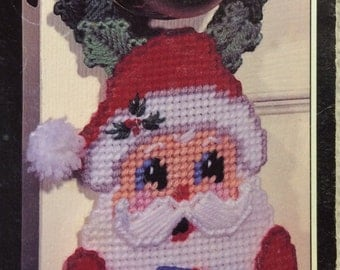 Santa doorknob hanger in plastic canvas