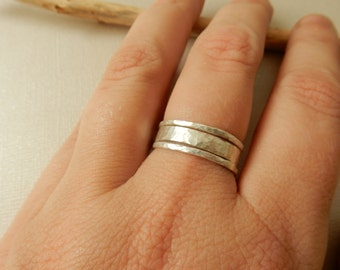 Sterling silver stacking rings set with hammered texture.