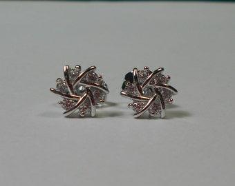 White Gold Plated Starburst CZ Stud Earrings