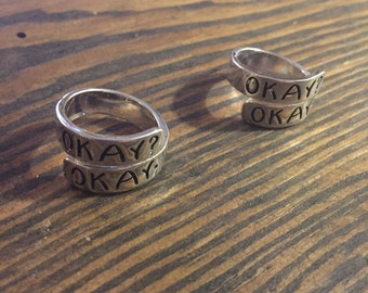Okay? Okay. Adjustible Alloy Wrap Ring