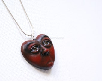 Original art as heart pendant: Love Is Silence!!! Dark red hand sculpted and hand painted portrait sculpture heart as art jewelry for her.