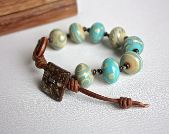 Bracelet porcelain beads, beige and turquoise, brown leather, adjustable coconut button closure, casual Summer, OOAK, knotted