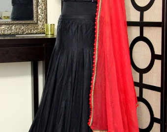 Black flowy lehenga with red duppatta and self blouse with embroidery