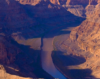 Purple shadows on river through Grand Canyon