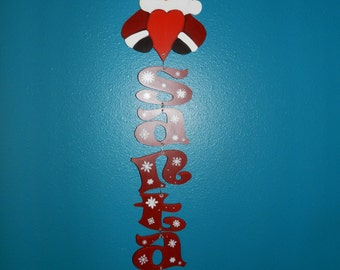 Santa holding heart holding the letters SANTA with elf hanging on