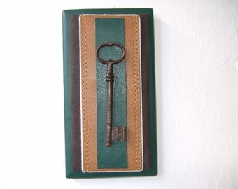 Old key, mounted on fine and delicate leathers