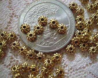 126 Tiny 2x4mm Antq Gold Pinwheel Spacers. Little Metal Rondelle Spacers. Better Than Daisy Spacer. Uniform, Burrless, Perfect.s