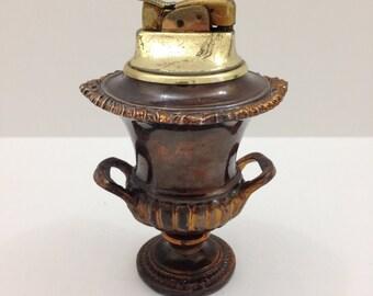 Vintage Dodge table top lighter in bronze colored trophy urn