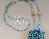 Lucille Kit, a beaded knit necklace purse (Blue Multi Colored)