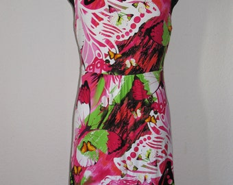 Beautiful summer dress women's clothing . Butterflies and colorful floral pattern