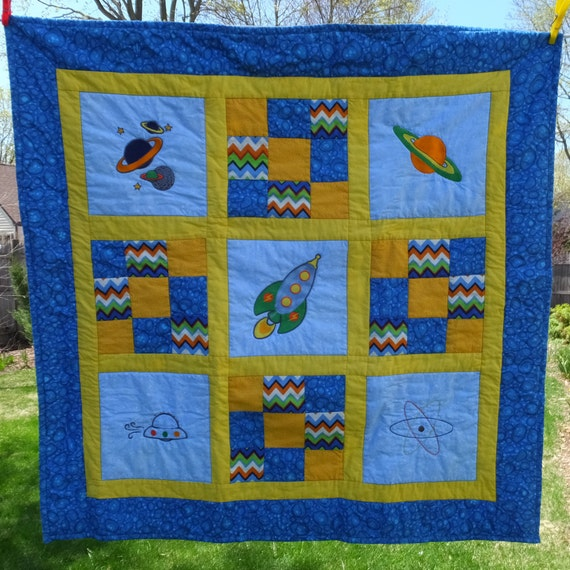 Baby boy quilt homemade baby quilt space theme nursery for Space baby fabric