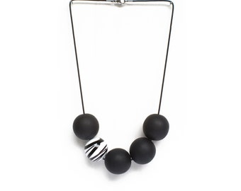 Statement necklace Black necklace with maxi glass bead white and black striped (Collection Liperlà Bubbles)