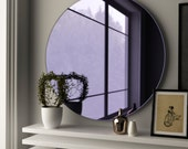 Round purple mirror. Midcentury modern glass mirror made with custom, hand made purple glass.