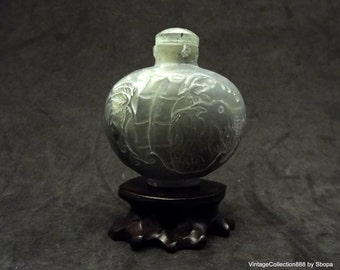 Chinese Snuff Bottle of Nephrite Jade with pattern of Rooster and Bamboo hand carved.