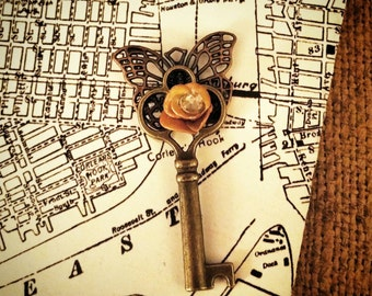 Butterfly skeleton key pendant