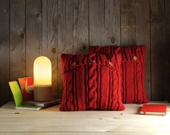 Strawberry red cable knit pillow cover with 3 wooden buttons.