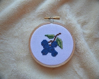 cross stitched blueberry hoop