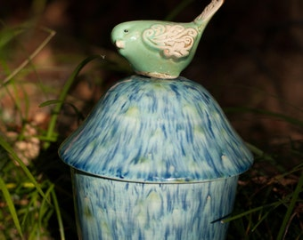 Blue and Green Urn Topped with a Sweet Little Green Bird