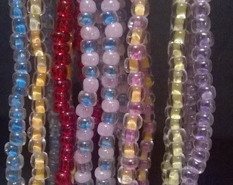Handmade beaded stretch bracelets in a variety of colors