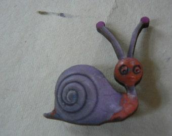 purple snail brooch statement