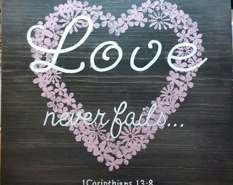 """Hand painted wood sign """"Love never fails"""""""