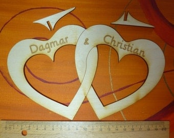 heart, wedding, two interlaced wooden hearts, 200 mm wide with engraving of spouses' names