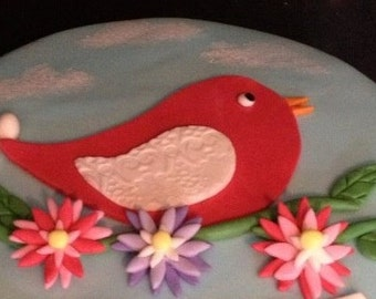 Sugarpaste bird on branch with flowers/leaves