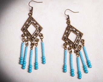 Earrings - Blue turquoise and antique bronze.