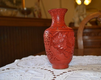 Asian cinnabar vase with fantastic engraving that gives a great dimentional look with blue enamelled top apr.2005