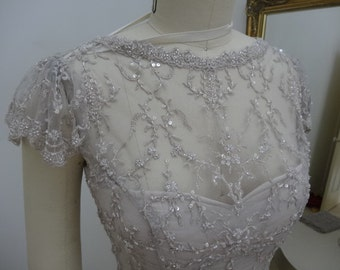 PATIENCE. Lace and netting top. Size 10.