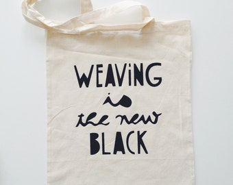 """Weaving is the new"" black cotton shopping bag"