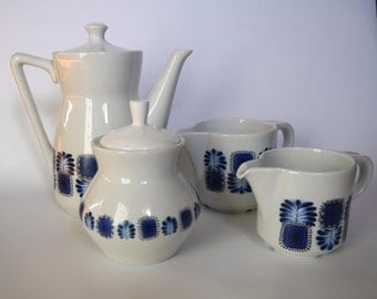 Together at the blue retro patterned in the 1960s Limoges porcelain.