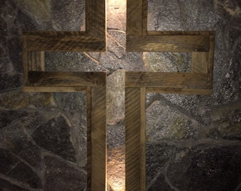 Cross with light inside. Built out of recycled barn wood